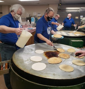 Kewanee Kiwanis Club members Brock Tumbleson, left, and Gary Montooth,  prepared pancakes for the club's annual fundraiser held in March. The event is the group's largest fundraiser and requires over 200 volunteer hours.