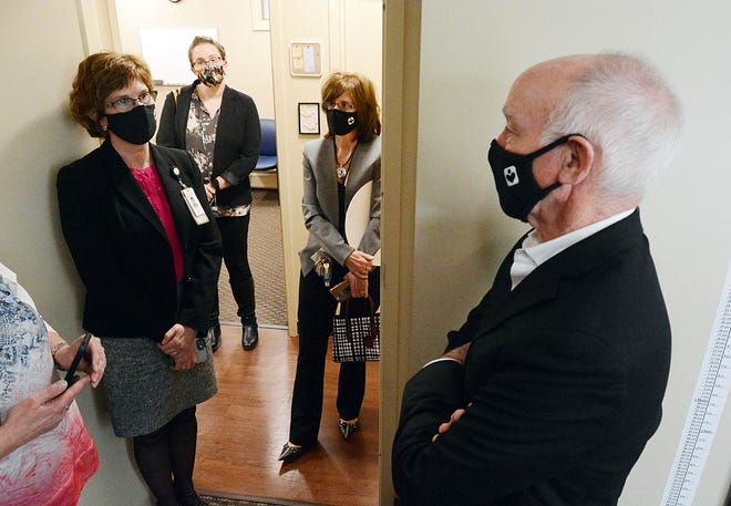 U. S. Representative Joe Courtney talks with Jennifer Granger, CEO and president of United Community & Family Services, left Thursday while touring UCFS Healthcare in the Moosup section of Plainfield. [John Shishmanian/ NorwichBulletin.com]