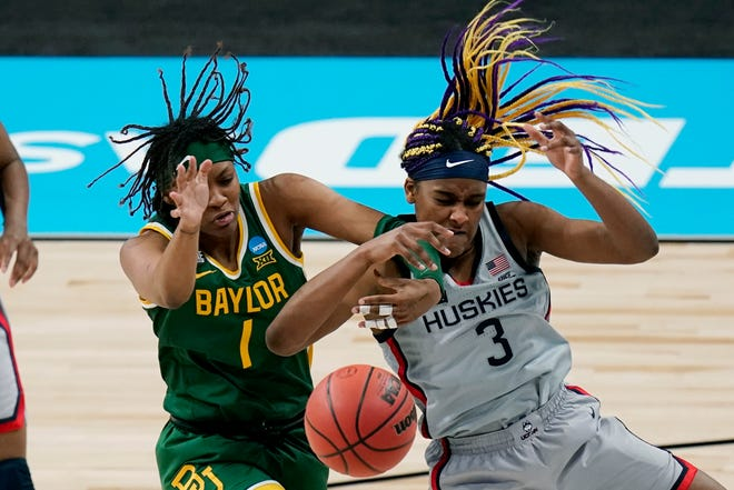 Baylor forward NaLyssa Smith (1) and UConn forward Aaliyah Edwards (3) battle for control of a rebound during the Huskies' 69-67 win the Elite Eight.