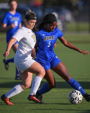 Washburn Rural senior Joy Ngibuini (right) was the Centennial League newcomer of the year and led Washburn Rural in scoring in 2019. She's one of 10 returning players for the Junior Blues, who finished second in Class 6A in 2019.