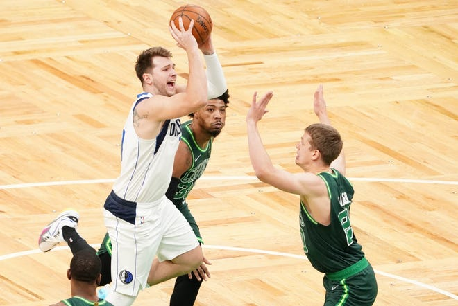 Mavericks guard Luka Doncic shoots against Celtics forward Moe Wagner, right, during the first quarter Wednesday night at TD Garden.