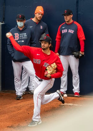 Connor Seabold, shown warming up in the bullpen earlier this spring, hurled six scoreless innings Monday against the Mets alternate camp.