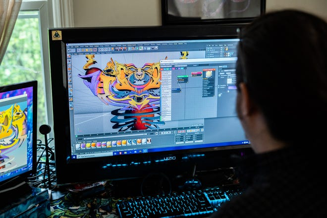 Digital artist and Asheville resident Jesse Yaun works at his home workstation on Wednesday, March 31, 2021.
