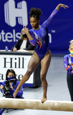 Florida gymnast Trinity Thomas performs her routine on the beam against Missouri at Exactech Arena on Jan. 29. Thomas is the nation's only gymnast to earn the maximum of five All-America honors. [Brad McClenny/The Gainesville Sun/File]