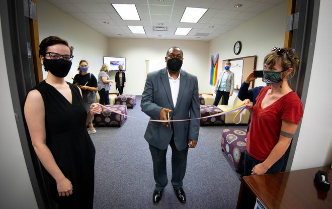 Santa Fe College President Paul Broadie II cuts a rainbow ribbon Monday to officially open the college's new LGBTQ+ student resource center. [Photo courtesy of Santa Fe College]