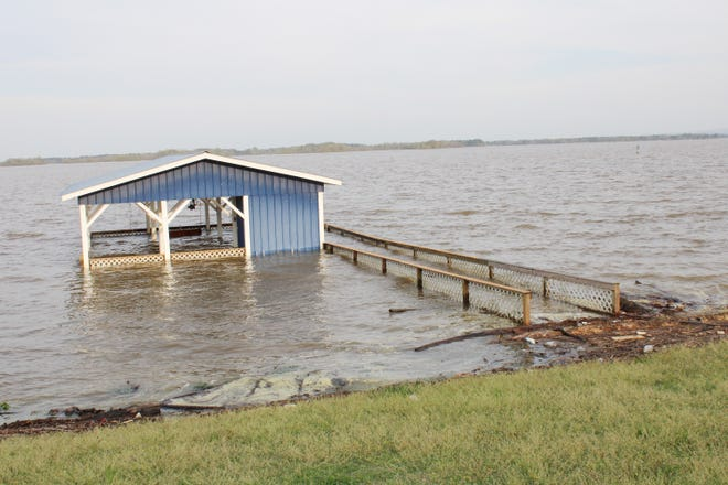 This boathouse along County Road 487 in Cherokee County, near Weiss Lake, is normally 4 feet above the lake's pool waters.