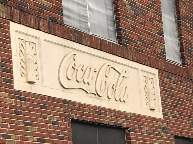 The Coca-Cola logo and the iconic bottle images that grace the former bottling plant on Walnut Street look unchanged, but the inside of the long-empty building has suffered serious deterioration.