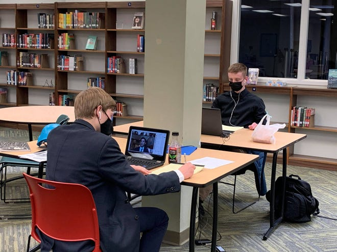 Grandview Heights High School students Connor Hayes (left) and Harvey Pierce participate in the National High School Mock United Nations conference, which was held virtually March 10-13. Nine GHHS students participated in the event, which could not be held in New York City as usual due to the COVID-19 pandemic.