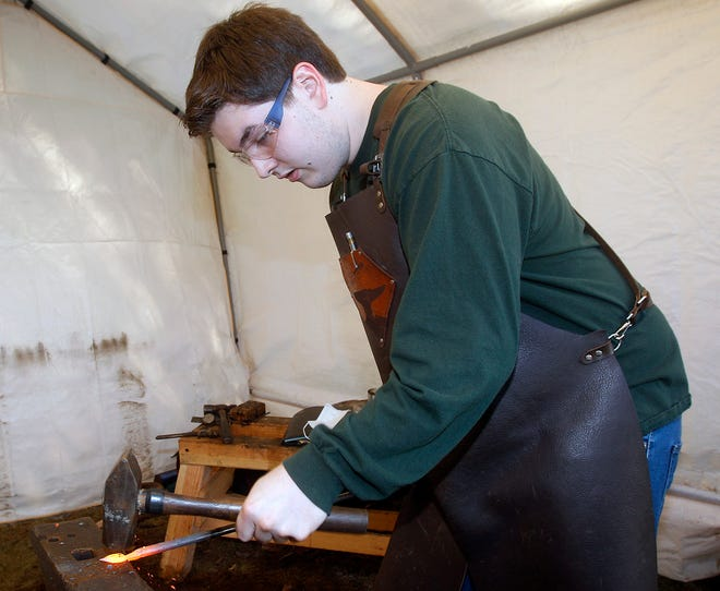 Nicholas Riolo,17, of Bellingham, works in his blacksmith shop out in the backyard of his family's house.