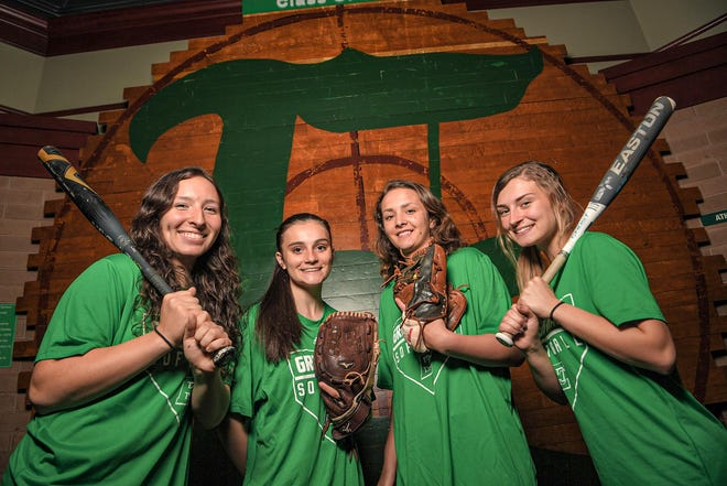 Easley first baseman Kyra McCarson, left, pitcher Maddie Haynes, shortstop Mary Kathryn Scott, and outfielder Emily Faasse lead the way for the Green Wave softball team this year.