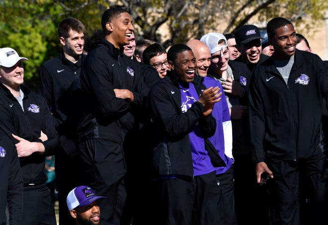 Members of the ACU Wildcats men's basketball team react as they watch video of the end of their game March 20 against Texas in the NCAA Tournament Wednesday at the university's Siggie Pavilion Park.