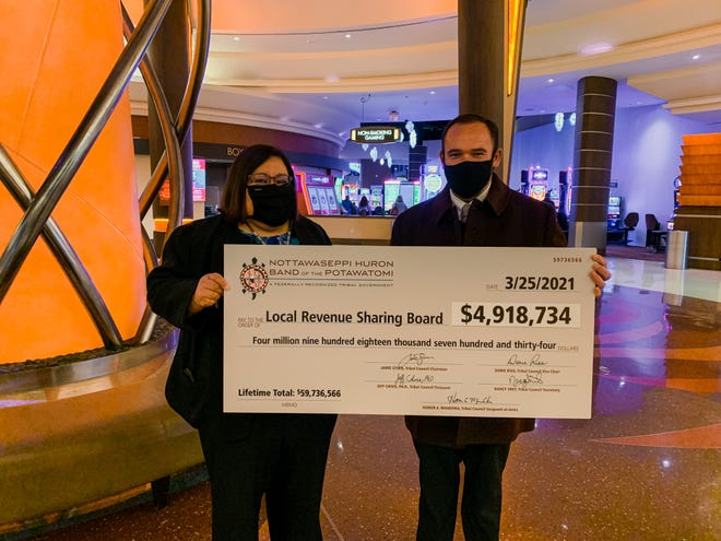 Marshall Mayor Joe Caron accepts a check on behalf of the Local Revenue Sharing Board from FireKeepers Casino and Hotel CEO Kathy George. Despite the pandemic, the Nottawaseppi Huron Band of the Potawatomi was still able to contribute $4.9 million to local schools and governments.