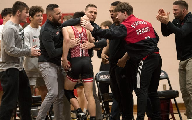 Kingsway's Nathan Taylor is congratulated by his teammates and coaches after Taylor defeated Delbarton's Tyler Vazquez, 2-1, during the 120 lb. bout of the wrestling meet held at Kingsway Regional High School on Thursday, April 1, 2021.