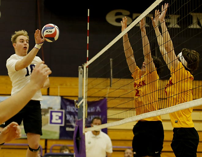 Elder High School middle hitter Mitchell Meyer uses a soft touch against Fenwick during a volleyball game at Elder March 31, 2021. Elder won 3-1.