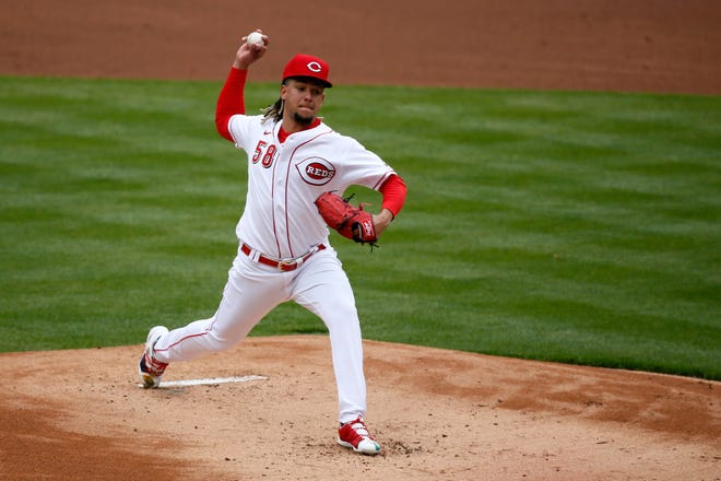 Cincinnati Reds starting pitcher Luis Castillo (58) delivers a pitch in the first inning of the MLB Opening Day game between the Cincinnati Reds and the St. Louis Cardinals at Great American Ball Park in downtown Cincinnati on Thursday, April 1, 2021. The Reds trailed 11-4 in the fifth inning.