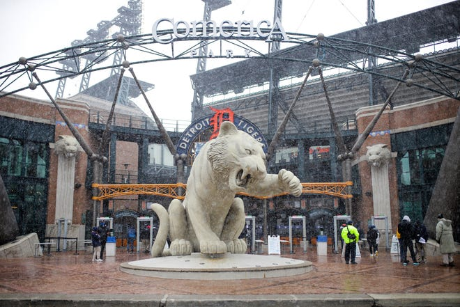 People walk outside Comerica Park on the Opening Day before the game between the Tigers and Cleveland Indians on April 1, 2021.