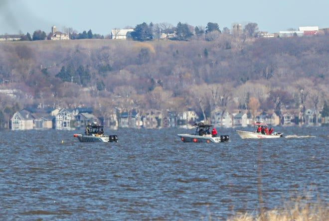Two Wisconsin DNR boats join the Fond du Lac County Sheriff's Office Thursday on Lake Winnebago to search for the second of two men who were reported drowned after their canoe capsized in rough waters Monday night.