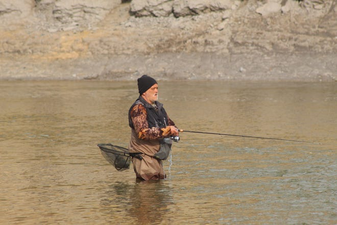 Fishermen, like this lone angler, went to River Cliff Park in Sandusky County Wednesday to try and catch walleye in the Sandusky River. The annual walleye run typically draws thousands of visitors to Sandusky County.