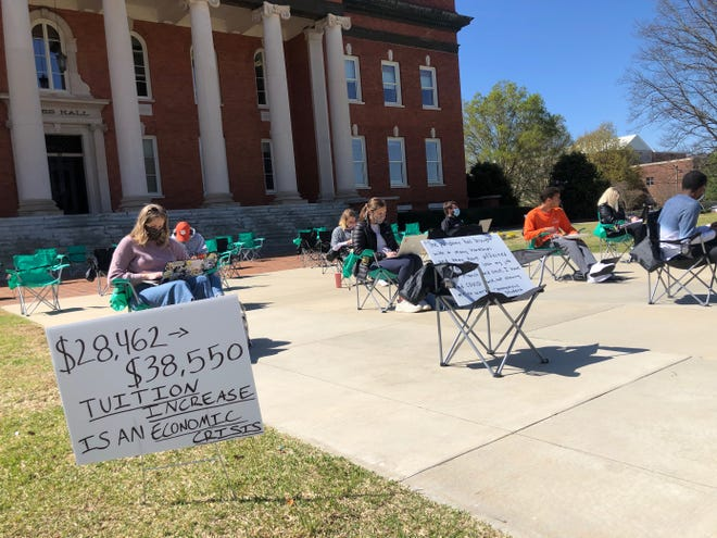 About a dozen people were taking part in the Clemson Tuition Freeze protest on Thursday morning April 1, 2021. The goal is to get the Board of Trustees to commit to not raising tuition for students next year.
