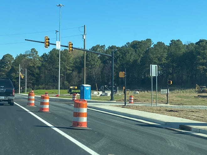 A new traffic light regulates cars coming off Interstate 40-West onto Highland Avenue.