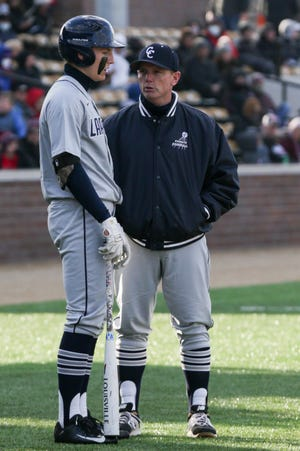 Central Catholic's A.J. Bordenet (21) and Central Catholic head coach Tim Bordenet speak during the second inning of an IHSAA baseball game, Wednesday, March 31, 2021 at Loeb Stadium in Lafayette.