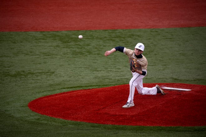 Lancaster's Trevor Roby (5) fires a pitch in to home plate against Whitehall during varsity baseball action at Beaver Field on March 31, 2021 in Lancaster, Ohio.