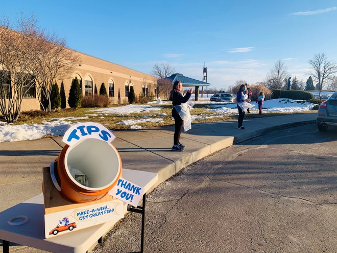 A tip jar sits outside St. Mary Church in Pinckney during a drive-thru fish fry. St. Mary Catholic School students in grades 5-8 worked as food runners for the fish fries and earned $3,300 in tips.