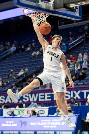 Boyle County's Luke Sheperson hangs on the rim after a fourth quarter dunk as as Boyle County recovered from an early lead by Paintsville to finish with a 48-23 run. Boyle County won the game 70-56 in the first round game in the Sweet Sixteen of the KHSAA basketball state tournament. April 1, 2021
