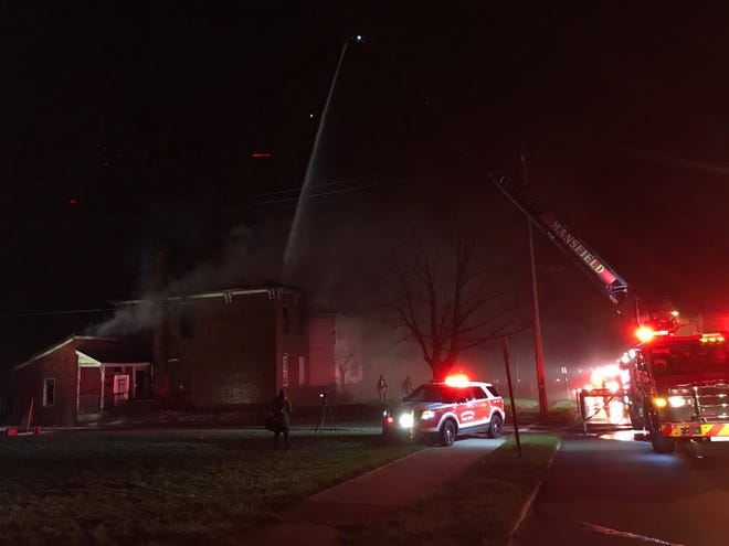 Mansfield firefighters had numerous fire trucks at the scene of a vacant house fire Wednesday night on Benton and West Fourth streets, including the ladder truck.