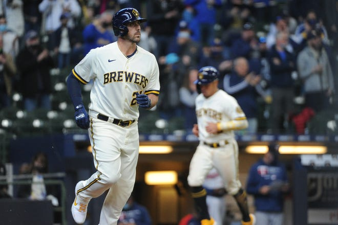 Brewers third baseman draws a walk with the bases loaded to score a run in the fourth inning Thursday.