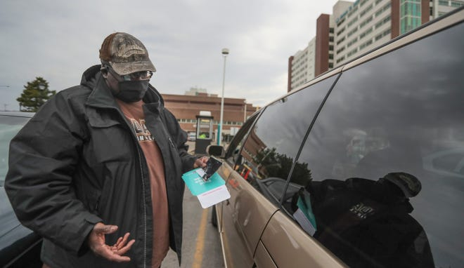 Marvin Dixon talks about the damage done to his Honda minivan at Aurora St. Luke's Medical Center in Milwaukee. Three hours after Dixon parked the van and was hospitalized, someone stole the catalytic converter.