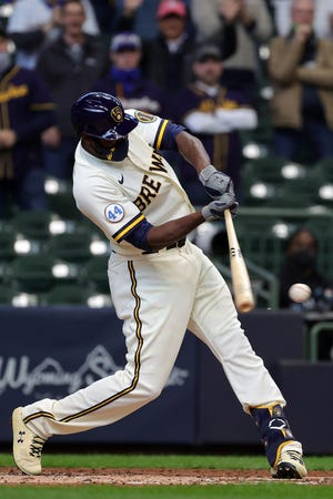 Lorenzo Cain swings at a pitch during the third inning against the Minnesota Twins on Opening Day at American Family Field.