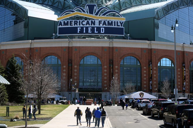 Fans arrive to American Family Field  for the first time since 2019 to watch the Brewers on opening day.