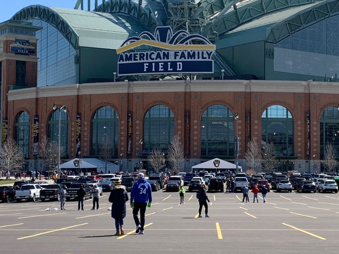 Fans head toward American Family Field before the Milwaukee Brewers' home opener.