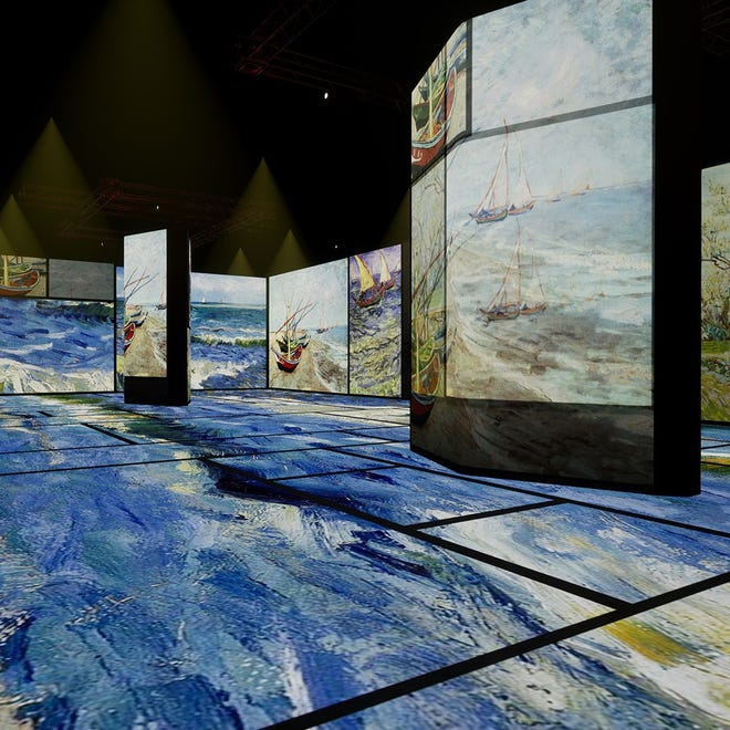 """'Beyond Van Gogh: An Immersive Experience"""" surrounds audience members with projected imagery from Van Gogh's paintings, including """"Fishing Boats on the Beach at Les Saintes-Maries-de-la-Mer."""""""
