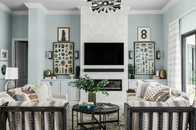 View of the living room from the kitchen in HGTV's 2021 Smart Home in Naples