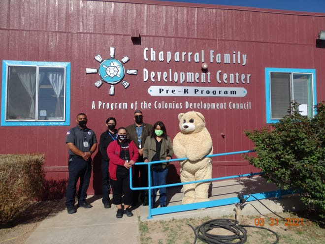 """Representatives donate books to Chaparral Family Development Center Wednesday as part of the MTC Facility's """"Literacy Project."""" Pictured from left to right: Officer Guillen, Officer Fragoso, Deborah Holguin, Cesar Gomez, Chaparral Family Development Center Director Maria Guzman and Teddy Bear."""