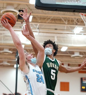 Spartan Luke Merchant puts up shot on the basket.