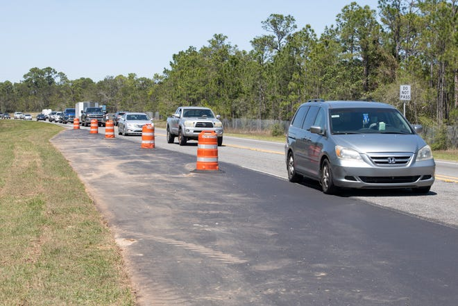 Vehicles on Thursday drive past the new extended right turn lane has been added from southbound Avalon Boulevard onto westbound Gulf Breeze Parkway in Gulf Breeze.