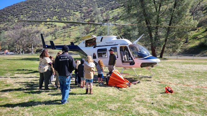 French Gulch-Elementary students meet pilot Justin Hambleton to ask questions and ride the helicopter on Tuesday, March 30, 2021.