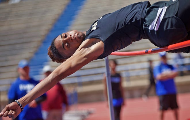 Coy McGee competes in the high jump for Abilene during the District 2-6A track and field meet in San Angelo on Thursday.