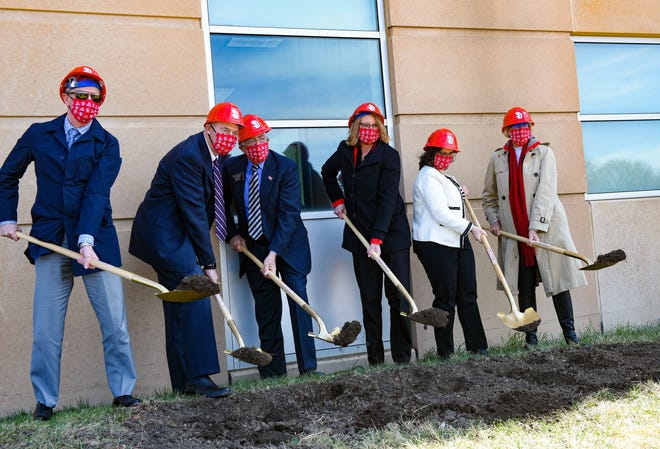 University and community leadership, including University of South Dakota President Sheila Gestring, Dean of the School of Health Sciences Haifa Abou Samra, Senator Arthur Rusch and Delta Dental President and CEO Scott Jones, break ground on the new School of Health Sciences building on Thursday, April 1, 2021, in Vermillion.