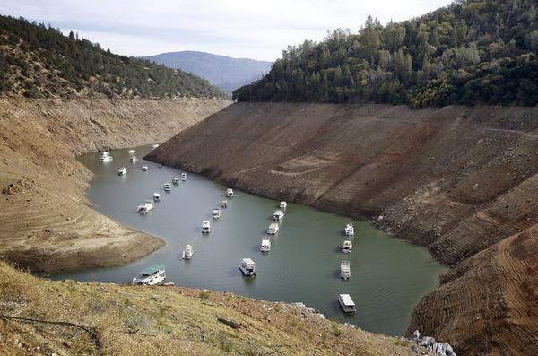 Houseboats float in the drought-lowered waters of Oroville Lake near Oroville, Calif. on Oct. 30, 2014.