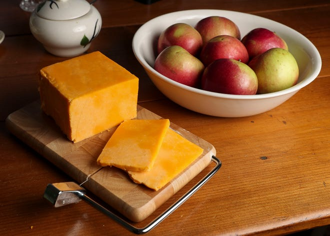 A block of Colby cheese is seen on a cheese slicer. Residents of Colby, Wisconsin, the town for which the cheese is named, have been pushing the state Legislature to designate the cheese as the official state cheese.