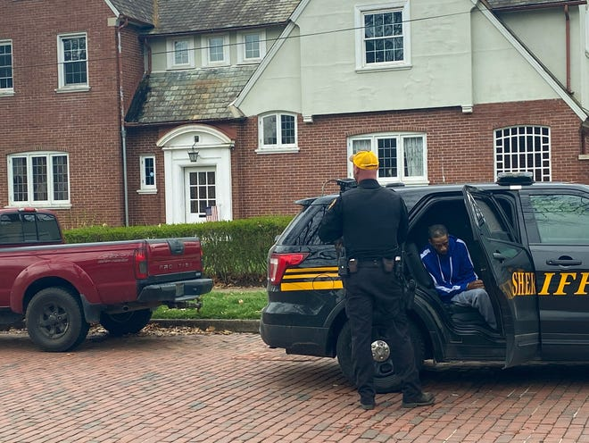 """Marcus """"Fep"""" Harris is arrested outside 910 Convers Ave. Wednesday afternoon."""