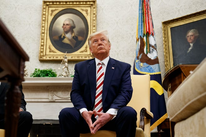 President Donald Trump pauses while speaking during a meeting with Romanian President Klaus Iohannis in the Oval Office of the White House, Tuesday, Aug. 20, 2019, in Washington.