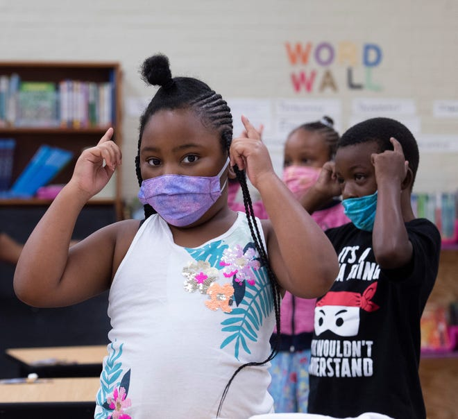 Kamiyah Sanders and Jonta Jenkins take part in the learning opportunities offered during the Children's Defense Fund Schools summer program last July at Dixon School of Arts and Sciences in Pensacola, Florida.