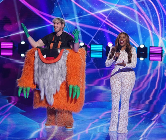 On the March 31 episode of Fox's 'The Masked Singer,' Grandpa Monster, the latest eliminated contestant, was revealed to be Logan Paul, left. He was joined on stage by host Niecy Nash.