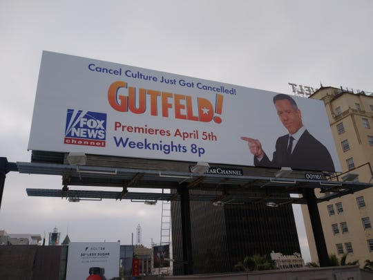 Fox News Channel put up a billboard promoting its new late-night weeknight show, 'Gutfeld!,' on Hollywood Boulevard in Los Angeles near the studio for ABC's late-night show, 'Jimmy Kimmel Live!'
