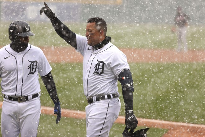 Miguel Cabrera (right) of the Detroit Tigers celebrates his first inning two run home run with Jeimer Candelario. His homer helped Detroit beat Cleveland 3-2 on opening day.